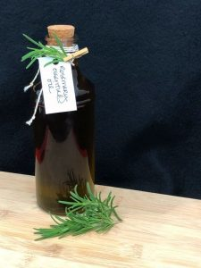 Homemade Rosemary Essential Oil in a Bottle